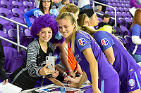 Orlando, FL - Saturday March 24, 2018: Orlando Pride forward Rachel Hill (15) takes a picture with fans after a regular season National Women's Soccer League (NWSL) match between the Orlando Pride and the Utah Royals FC at Orlando City Stadium. The game ended in a 1-1 draw.