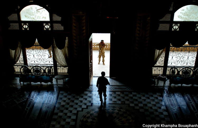 U.S. soldiers snap a picture in one of Saddam Hussein's palace in Tikrit, Iraq on May 16, 2003.  (photo by Khampha Bouaphanh)