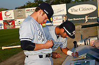 Staten Island Yankees shortstop Cito Culver #2 and third baseman Dante Bichette #50 sign autographs before a game one of the NY-Penn League Championship Series against the Auburn Doubledays at Falcon Park on September 12, 2011 in Auburn, New York.  Staten Island defeated Auburn 9-2.  (Mike Janes/Four Seam Images)