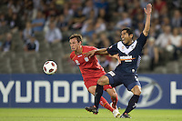 MELBOURNE, AUSTRALIA - OCTOBER 30: Surat Sukha of the Victory and Fabian Barbiero of United compete for the ball during the round 12 A-League match between the Melbourne Victory and Adelaide United at Etihad Stadium on October 30, 2010 in Melbourne, Australia.  (Photo by Sydney Low / Asterisk Images)