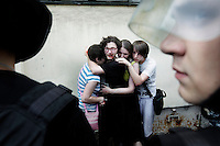 Supporters try to protect LGBT activist, Kiriee Fedorov, from further attacks after he was violently assualted by anti-gay protestors during a Gay Pride Rally on 29 June 2013. He was later arrested. On 30 June 2013, Russian President Vladimir Putin signed into law an ambiguous bill banning the 'propaganda of nontraditional sexual relations to minors'. The law met with widespread condemnation from human rights and LGBT groups. The law has since been used to ban Gay Pride Rallies in the city. (MANDATORY CREDIT   photo: Mads Nissen/Panos Pictures /Felix Features)