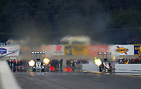 Oct. 1, 2011; Mohnton, PA, USA: NHRA top fuel dragster driver Larry Dixon (left) races alongside Rod Fuller during qualifying for the Auto Plus Nationals at Maple Grove Raceway. Mandatory Credit: Mark J. Rebilas-
