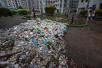 Marine debris and plastics pollution cover a public housing estate in the aftermath of the passing of Typhoon Hato, Heng Fa Chuen, Hong Kong, China, 23 August 2017.<br /> ALEX HOFFORD