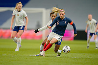 LE HAVRE, FRANCE - APRIL 13: Eugénie le Sommer of France moves with the ball during a game between France and USWNT at Stade Oceane on April 13, 2021 in Le Havre, France.