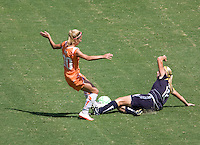Sky Blue FC midfielder Kacey White is tackled by LA Sol defender Katie Larkin. The Sky Blue FC defeated the LA Sol 1-0 to win the WPS Final Championship match at Home Depot Center stadium in Carson, California on Saturday, August 22, 2009...