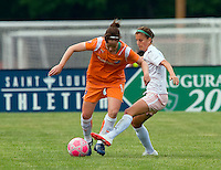 St Louis Athletica forward Angie Woznuk (11) knocks the ball away from Sky Blue FC  midfielder Collette McCallum (14) during a WPS match at Anheuser-Busch Soccer Park, in St. Louis, MO, June 7, 2009. Athletica won the match 1-0.