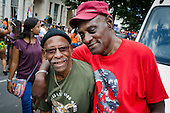 Darcus Howe, writer, broadcaster and social commentator, with the Mangrove carnival band, of which he was a founder member, Notting Hill Carnival 2013..
