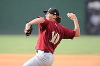 Relief pitcher Bret Mitchell (10) of the Savannah Sand Gnats delivers a pitch in a game against the Greenville Drive on Sunday, August 24, 2014, at Fluor Field at the West End in Greenville, South Carolina. Greenville won, 8-5. (Tom Priddy/Four Seam Images)