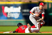 Jamodrick McGruder #2 of the Texas Tech Red Raiders steals second base ahead of the tag from Houston Cougars second baseman Chase Jensen #17 at Minute Maid Park on March 4, 2012 in Houston, Texas.  The Red Raiders defeated the Cougars 10-4.  Brian Westerholt / Four Seam Images