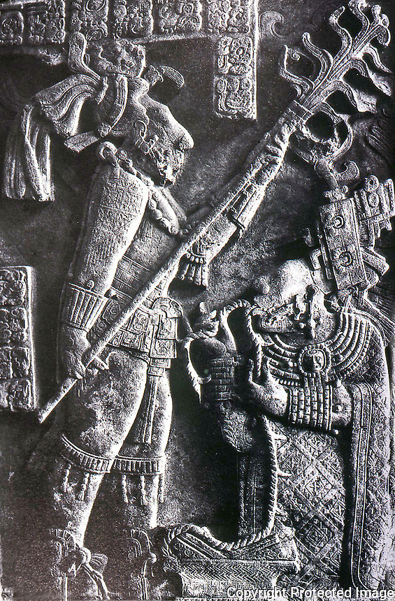 World Civilization:  Mayan Culture--bloodletting rite. The ruler, Shield Jaguar, holds a giant torch over his kneeling wife, Lady Xoc, who pulls a thorn-lined rope through her tongue.  YAXCHILAN,  28 Oct. AD 709.