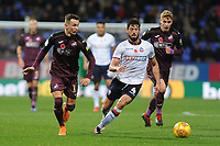 Bersant Celina of Swansea City battles with Jason Lowe of Bolton Wanderers during the Sky Bet Championship match between Bolton Wanderers and Swansea City at the Macron Stadium in Bolton, England, UK. Saturday 10 November 2018