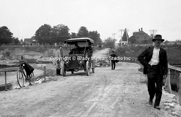 Westmoreland County PA:  Brady Stewart and friends stopped along the road to pose for a photograph in the new 1906 Buick Model F.  Two men walking home from town and the Fair View Hotel is in the background (over the shoulder of the man walking)