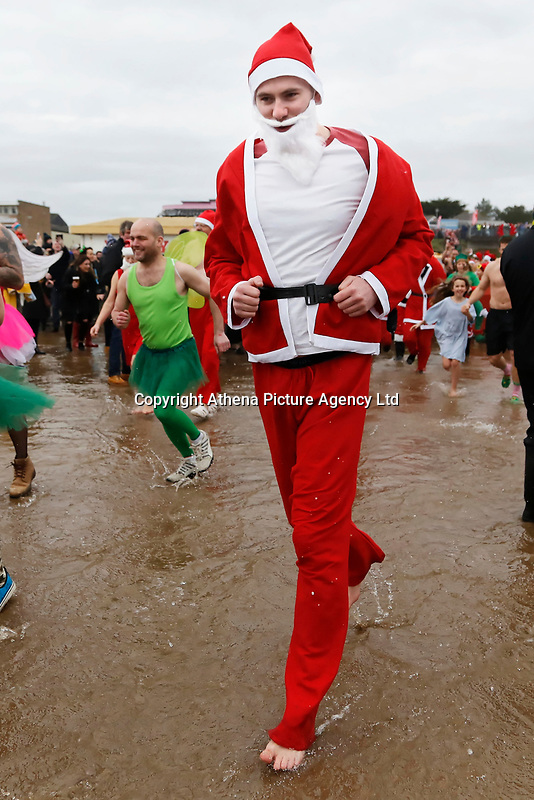 A man in a Santa outfit