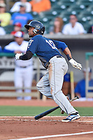 Mobile BayBears shortstop Raul Navarro (13) swings at a pitch during a game against the Tennessee Smokies on May 27, 2015 in Kodak, Tennessee. The Smokies defeated the BayBears 3-2. (Tony Farlow/Four Seam Images)