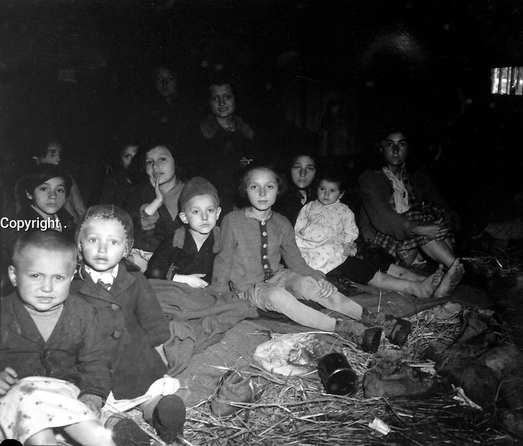 These women and children were liberated when the concentration camp for the Jewish prisoners at Lambach, Austria, was overrun by the 71st Inf. Div.  Death rate at the camp, mostly from starvation, was reputed to be 200 to 300 a day.  May 7, 1945.  Sgt. Robert Holliway.  (Army)<br /> NARA FILE #:  111-SC-266491<br /> WAR & CONFLICT BOOK #:  1110
