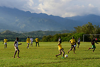 UGANDA, Kasese, St. John´s Seminary Kiburara, young seminarians play soccer infront of mountains /Jugendliche spielen Fussball