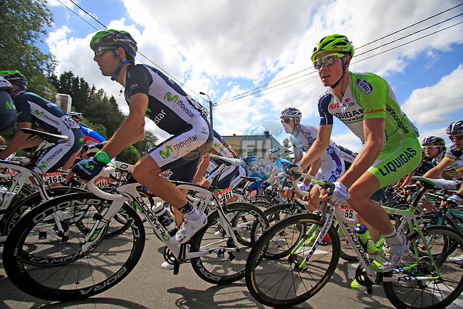 The peloton including Alejandro Valverde (ESP) Movistar Team and Dominik Nerz (GER) Liquigas-Cannondale round a hairpin to climb the Cote de Lierneux during Stage 1 of the 99th edition of the Tour de France, running 198km from Liege to Seraing, Belgium. 1st July 2012.<br /> (Photo by Eoin Clarke/NEWSFILE)
