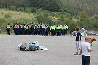 Pictured: Police officers arrive. Monday 31 August 2020<br /> Re: Around 70 South Wales Police officers executed a dispersal order at the site of an illegal rave party, where they confiscated sound gear used by the organisers in woods near the village of Banwen, in south Wales, UK.
