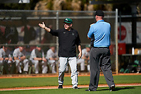 Dartmouth Big Green head coach Bob Whalen argues a call with the home plate umpire during a game against the Omaha Mavericks on February 23, 2020 at North Charlotte Regional Park in Port Charlotte, Florida.  Dartmouth defeated Omaha 8-1.  (Mike Janes/Four Seam Images)