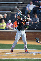 Zack Collins (0) of the Miami Hurricanes at bat against the Wake Forest Demon Deacons at Wake Forest Baseball Park on March 21, 2015 in Winston-Salem, North Carolina.  The Hurricanes defeated the Demon Deacons 12-7.  (Brian Westerholt/Four Seam Images)