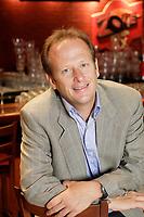 """september 8, 2006 File Photo -<br /> <br /> Jean Bedard,<br /> President et chef de la direction Ð Groupe Sportscene inc.<br /> <br /> Groupe Sportscene inc. (TSX ; symbole SPS.A<br /> )  exploite depuis 1984 la premiZre cha""""ne de resto-bars d ambiance sportive au Quebec : La Cage aux Sports. AxŽe sur le concept Ç Sport, Gang, Fun C, La Cage aux Sports est implantŽe ? la grandeur du QuŽbec ot elle compte 46 Žtablissements, lesquels accueillent chaque annŽe prZs de six millions de consommateurs. Ce rŽseau, qui jouit dOune forte image de marque, comprend 31 Cages que la SociŽtŽ gZre en propriŽtŽ exclusive ou en coentreprise, ainsi que 15 franchises. Employant au total environ 2 000 personnes dans les restaurants et au siZge social, La Cage aux Sports base son succZs commercial et financier sur trois principaux volets : une qualitŽ de restauration comparable aux meilleures cha""""nes de sa catŽgorie, un marketing hors pair, axŽ sur la promotion dynamique de sa marque de commerce et une gestion opŽrationnelle parmi les plus efficaces de lOindustrie. En appui ? la promotion de sa marque de commerce, la SociŽtŽ exerce Žgalement certaines activitŽs complŽmentaires gravitant autour dOŽvŽnements ? caractZre sportif.<br /> <br /> <br /> photo : c)  Images Distribution"""
