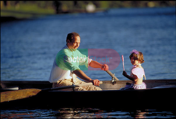man rowing boat with young girl