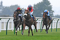 Winner of The Swallowcliffe Handicap (Div 1) Burguillos (red) ridden by Eoin Walsh and trained by Luke McJannet  during Horse Racing at Salisbury Racecourse on 13th August 2020