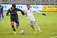 KANSAS CITY, KS - OCTOBER 24: Sam Vines #13 Colorado Rapids held off by Jaylin Lindsey #26 of Sporting Kansas City during a game between Colorado Rapids and Sporting Kansas City at Children's Mercy Park on October 24, 2020 in Kansas City, Kansas.