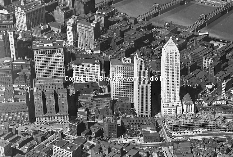 Pittsburgh PA:  View of the new Gulf Building and construction of the Post Office Federal Courts building.  Construction started in 1930 and completed in 1932. The building has 44 floors and was the largest building in Pittsburgh until 1970.<br /> <br /> Other buildings in the image include Koppers Building, Bell Telephone Building, William Penn Hotel, Oliver Building, and the 3 sister bridges in the background.