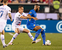 PHILADELPHIA, PA - JUNE 30: Aaron Long #23 defends against Jafar Arias #19 during a game between Curaçao and USMNT at Lincoln Financial Field on June 30, 2019 in Philadelphia, Pennsylvania.