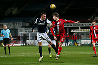 27th March 2021; Dens Park, Dundee, Scotland; Scottish Championship Football, Dundee FC versus Dunfermline; Lee Ashcroft of Dundee competes in the air with Josh Edwards of Dunfermline Athletic