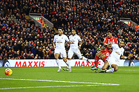 Kyle Bartley tackles Jordan Ibe and hits his own goal post during the Barclays Premier League Match between Liverpool and Swansea City played at Anfield, Liverpool on 29th November 2015