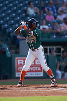 Osiris Johnson (1) of the Greensboro Grasshoppers at bat against the West Virginia Power at First National Bank Field on August 9, 2018 in Greensboro, North Carolina. The Power defeated the Grasshoppers 5-3 in game one of a double-header. (Brian Westerholt/Four Seam Images)