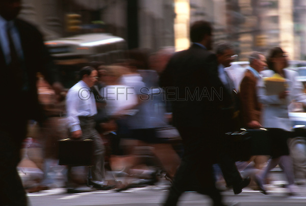 AVAILABLE FOR COMMERCIAL AND EDITORIAL LICENSING EXCLUSIVELY FROM GETTY IMAGES.  Please search for image # 10049886 on www.gettyimages.com<br /> <br /> Going to Work - People Crossing the Street in Midtown Manhattan at Rush Hour, New York City, New York State, USA