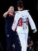 10 AUG 2012 - LONDON, GBR - Sarah Stevenson (GBR) (right) of Great Britain is comforted by her husband and coach Steve Jennings (left) after her women's -67kg category preliminary round contest defeat to Paige McPherson during the London 2012 Olympic Games Taekwondo at Excel in London, Great Britain .(PHOTO (C) 2012 NIGEL FARROW)