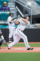 Connor Owings (6) of the Coastal Carolina Chanticleers follows through on his swing against the Bryant Bulldogs at Springs Brooks Stadium on March 13, 2015 in Charlotte, North Carolina.  The Chanticleers defeated the Bulldogs 7-2.  (Brian Westerholt/Four Seam Images)