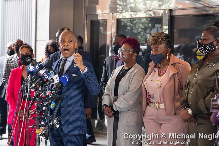 """Reverend Al Sharpton, left of center, speaks at a press conference in response to the George Floyd and Duante Wright cases along with Lesley McSpadden, mother of Michael Brown, center, Gwen Carr, mother of Eric Garner, right of center; and Sybrina Fulton, mother of Trayvon Martin, right; after the """"Mother's of the Movement"""" panel at the National Action Network (NAN) Virtual Convention 2021 in New York on Wednesday, April 14, 2021. Photograph by Michael Nagle"""