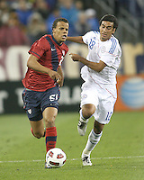 Timothy Chandler(21) of the USA MNT races away from Marcelo Alejandro Estigambia(18) of Paraguay during an international friendly match at LP Field, in Nashville, TN. on March 29, 2011.Paraguay won 1-0.