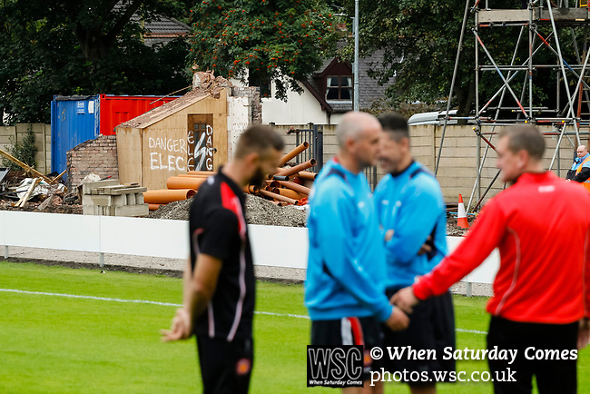 Salford City 2 FC United of Manchester 1, 15/07/2017. Moor Lane, Pre Season Friendly. FC United players and officials check the pitch. The remains of the old Main Stand are in the background. Salford City v FC United of Manchester in a pre season friendly at Moor Lane Salford. Photo by Paul Thompson.
