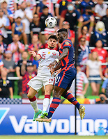 AUSTIN, TX - JULY 29: Daryl Dike #11 of the United States and Bassam Al Rawi #15 of Qatar go up for a header during a game between Qatar and USMNT at Q2 Stadium on July 29, 2021 in Austin, Texas.