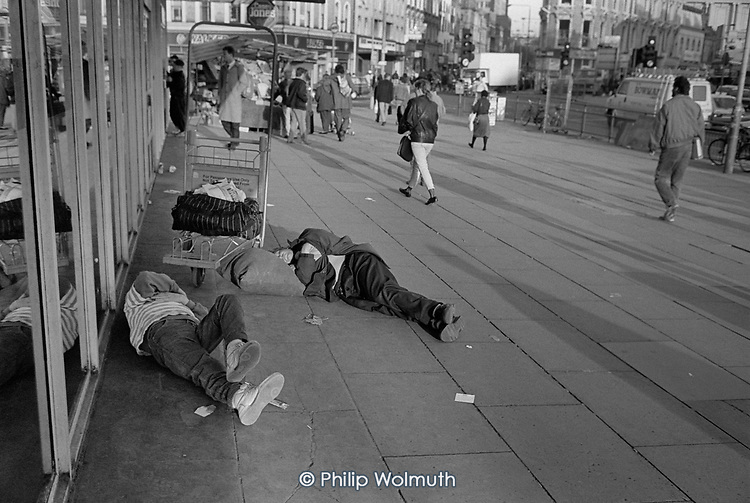 Two men sleeping on the pavement outside Kings Cross train station, London.  The area had a reputation for drug and alcohol misuse, and prostitution.