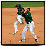Third baseman Tanner Nishioka (30) of the Greenville Drive is lifted off the ground by Victor Acosta after getting a walk-off hit to win a game against the Asheville Tourists, 7-6, on Sunday, June 3, 2018, at Fluor Field at the West End in Greenville, South Carolina. Greenville won, 7-6. (Tom Priddy/Four Seam Images)