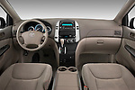 Straight dashboard view of a 2010 Toyota Sienna CE 8 Passenger.