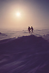 Alaska, Prudhoe Bay, North Slope, Beaufort Sea, USA, wildlife researchers walk into blowing snow on sea ice offshore of the oilfied complex, Arctic spring,..