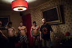 Men, employes of Moscow Marusya, night club for women practice in a dance at the one of club's room. Moscow. Russia. 2014