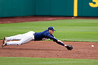 T.J. Bennett (6) of the Oral Roberts Golden Eagles misses a ground ball on a diving attempt during a game against the /m/ on March 27, 2011 at Hammons Field in Springfield, Missouri.  Photo By David Welker/Four Seam Images