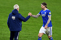 Mick McCarthy Manager of Cardiff City shakes hands with Aden Flint of Cardiff City at full time during the Sky Bet Championship match between Swansea City and Cardiff City at the Liberty Stadium in Swansea, Wales, UK. Saturday 20 March 2021