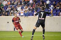 Fabian Espindola (7) of Real Salt Lake tries to chip New York Red Bulls goalkeeper Frank Rost (1). Real Salt Lake defeated the New York Red Bulls 3-1 during a Major League Soccer (MLS) match at Red Bull Arena in Harrison, NJ, on September 21, 2011.