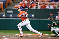 Center fielder Bryce Teodosio (31) of the Clemson Tigers bats in a game against the William and Mary Tribe on February 16, 2018, at Doug Kingsmore Stadium in Clemson, South Carolina. The catcher is Hunter Smith. Clemson won, 5-4 in 10 innings. (Tom Priddy/Four Seam Images)
