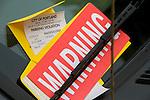 Parking ticket under windshield wiper